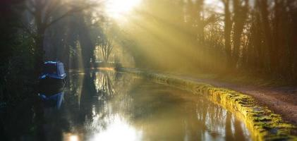 Ray of light on old canal in Bollington, Cheshire, England photo
