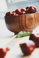 Cherry berries in the wooden bowl