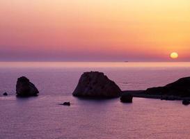 Aphrodites rock at sunset, Cyprus. photo