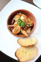 Spanish tapas dish, sizzling prawns with chili and garlic