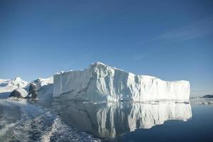 Large iceberg and its reflection in the southern ocean photo