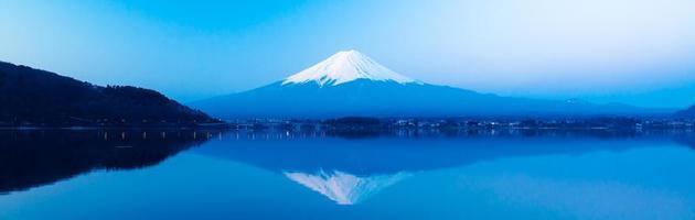 Panoramic view of Mt  Fuji rises above Lake Kawaguchi photo