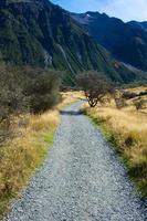 Gravel road in mountain range photo