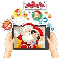 Papá Noel en la pantalla de la tableta con el icono de redes sociales