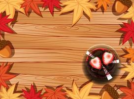 Top view of wooden table with dessert and autumn leaves element