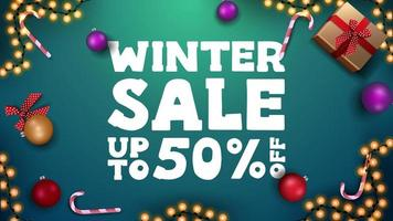 Winter sale, green discount banner with Christmas balls