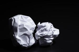 Crumpled paper on black background