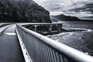 Black and white of bridge near the ocean