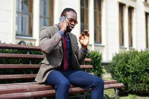 African American business man talks on the phone