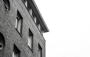 Grayscale of a brick building