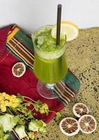 Lemon fruit juice cocktail on a cloth