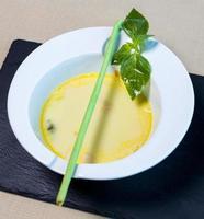 Organic green soup in a white bowl