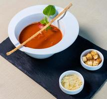 Tomato red soup with bread crumbs