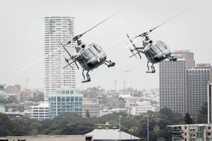 Sydney, Australia, 2020 - Two helicopters flying in the city