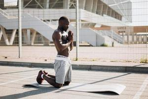 Man does meditation during his morning work out photo