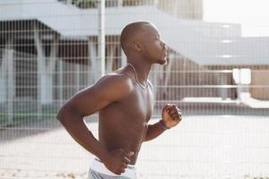 African American man runs along the street