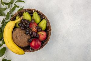 Assorted fruit on neutral background photo