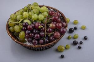 Assorted grapes on neutral background