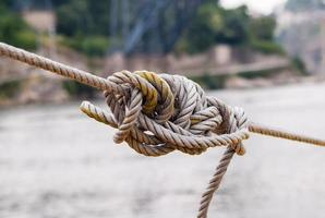 Tangled knot in tightened rope photo