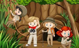 Scene with group of scouts exploring the cave vector