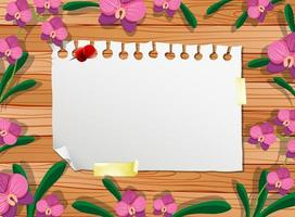 Top view of blank paper on table with leaves and pink orchids elements