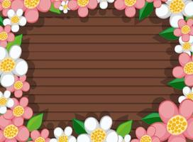 Top view of blank wooden table with leaves and pink and white flower elements