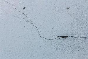 Cracked texture of a cement wall photo