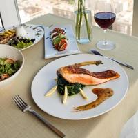 Beautiful salmon meal with lemon and red wine
