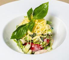 Tasty vegetable salad herbs on it