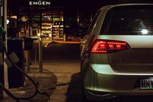 Uitenhage, South Africa, 2020 - Volkswagen Golf at a gas pump at night
