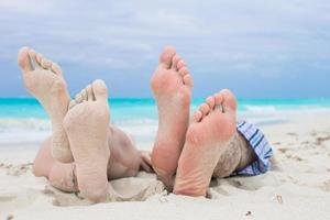 Close-up of two people on a beach photo