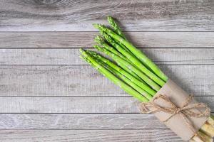 Fresh asparagus on wooden table photo