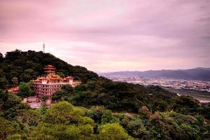 Taipei, Taiwan, 2020 - Shrine on a mountain at sunset