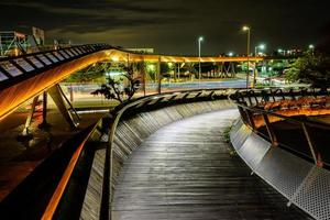 Wooden bridge with lights in a city at night photo