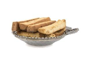 Toast sticks in a silver bowl