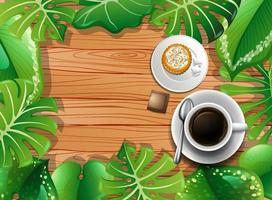 Top view of wooden table with dessert and coffee and leaves element