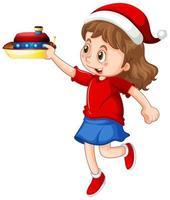 Linda chica con sombrero de navidad y jugando con su juguete sobre fondo blanco.