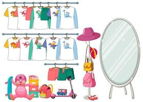 Children clothes hanging on clothes rack with accessories on white background
