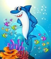 Happy shark cartoon character in the underwater scene with many exotic fishes