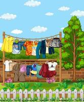 Many clothes hanging on a line outside the house scene
