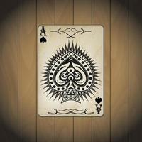Ace of spades, poker cards on wood background vector