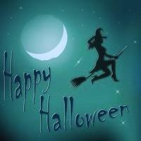 Halloween night witch riding broom