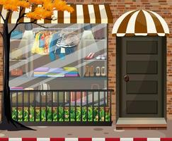 Front of clothing store showcase with clothes and accessories vector