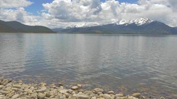 Lake Shore With Rocky Mountains in Background 4K