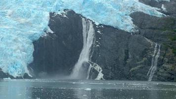 Alaska Waterfall Crashes Into Icy Waters 4K