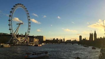 london eye, big ben, thames river from bridge in inglaterra 4k