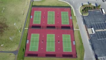 People playing tennis aerial