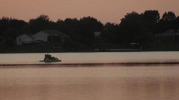Boating on the Water at Sunset