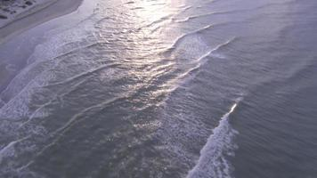 Aerial of beach at sunset