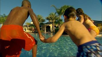 Kids jump into resort swimming pool video